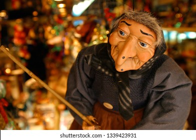 Befana puppet in a candy store