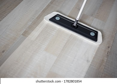 before and after cleaning concept - close up of microfiber floor mop on wooden background with copy space