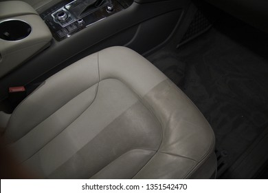 Before and after of leather cleaning service in a luxury car.