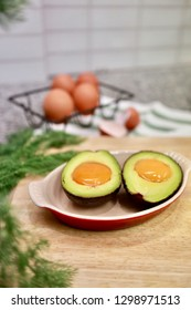 Before Baking. Eggs in Avocado with Nutritional Yeast ( Vegan Cheese )