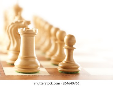 Before the battle - white chess pieces standing on a chessboard - closeup