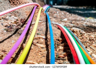 Before they are put in the ground the internet cables are spread out on the street