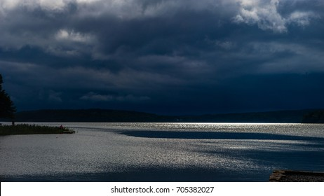 Before the thunderstorm over lake Malaren when the sun still glittering in the water and the dark clouds pile up over the skyline