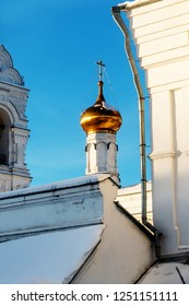 Before us are fragments of buildings of the Perm Holy Trinity Stefanov monastery, a bell tower with a belfry and one of the towers of the altar part of the monastery with a gilded dome.