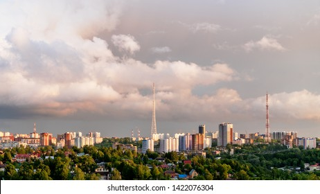 Before us under the cloudy stormy sky in the rays of the sunset is one of the Central districts of the city of Perm.