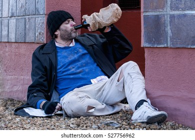 Beggar drinking alcohol on the street