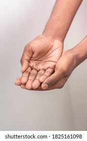 Beggar hand signs - Hand man holds a handful, hands together. Two hands with open palms both tightly together - international hand gesture isolated on white background with copy space