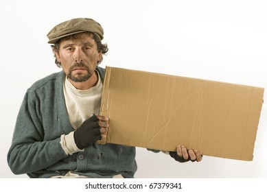"""A beggar holding a piece of corrugated cardboard. Suitable for adding text like """"will work for food"""""""