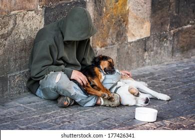 beggar, homeless with two Dogs near Charles Bridge, Prague, Czech republic