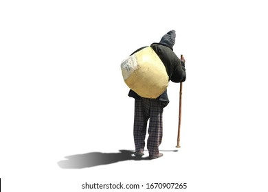 A beggar man with a bag over his shoulders and a stick goes on a white background with shadow.