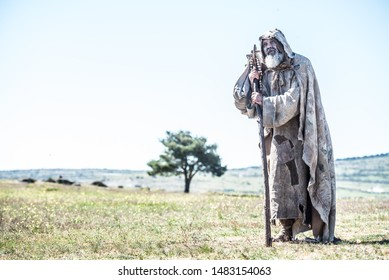Beggar, poor walking in the countryside, praising God