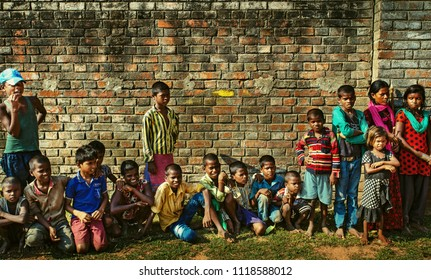 The beggars are standing in line waiting to receive donations on Octorber, 2017 in Kumrokhali, West Bengal, India