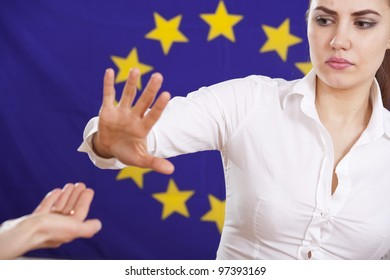 begging hand to european union and rejecting or stop gesture from a young woman