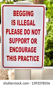 Begging is illegal, please do not support or encourage this practice sign posted on fence post
