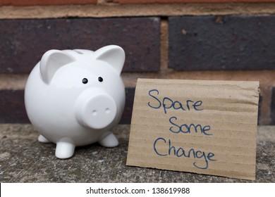 Begging piggy bank concept