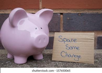 Begging piggy bank concept. Pink pig.