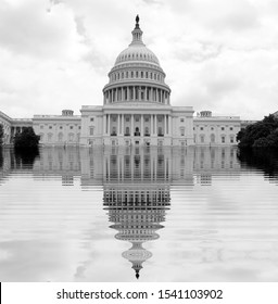 The beginning of the end, climate change does not exist, phrase of D.Trump, climate change, Artistic black and white photograph of the congress USA flooded by the rising sea,