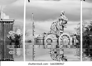 The beginning of the end,  climate change does not exist, phrase of D.Trump, dystopian photography black and white photo of the Cibeles fountain, Madrid, Spain, flooded by the rising sea waters