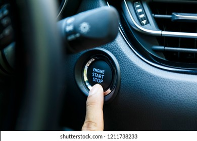 The beginning of the journey by car,Focus on finger. hand presses the start button of the car