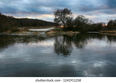 The beginning of winter, a beautiful landscape with trees by the river