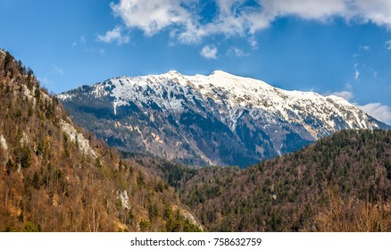 Begunjscica mountain in spring view from Sv. Peter nad Begunjami. Mounatin and forest hills in Slovenia.