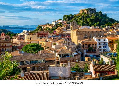 Begur Old Town and castle with Bay of Estartit and Pyrenees mountains on spanish Costa Brava coast, Catalonia, Spain