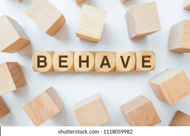 Behave word on wooden cubes