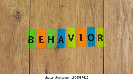 Behavior symbol. Concept word 'behavior' on colored papers on a beautiful wooden background, copy space. Business, psychology and behavior concept.