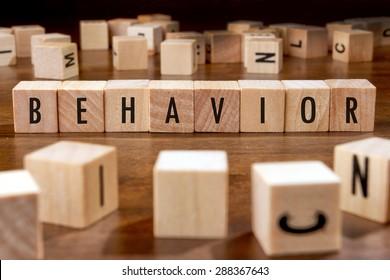 BEHAVIOR word written on wood block