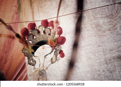 Behide the scene of cantonese chinese opera show dummy, Crown chinese opera accessory hanging on rope. element concept or cultural concept, background with copy space for put text.