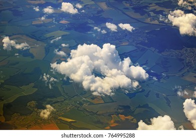 behind the clouds, a view of the earth from a height of 10,000 meters