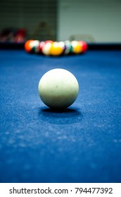 Behind the Cue ball on a Pool table.