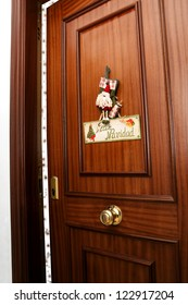 Behind the door with holiday decor awaits the spirit of Christmas./Welcome to Christmas.