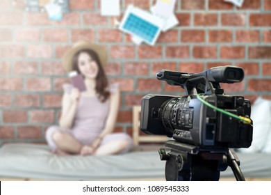 Behind the film shooting video,movie,vlog digital camera. Young beautiful asian woman taking photo,cinema broadcast television,show production maker. Entertainment news with footage equipment concept.