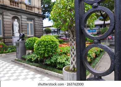 Behind the iron gate is the garden pathway into the National Theater in San Jose, Costa Rica.