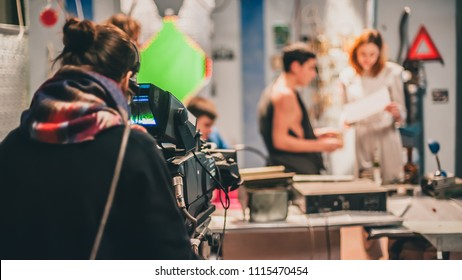 Behind the scene. Actor in front of the camera on the film set in film studio.