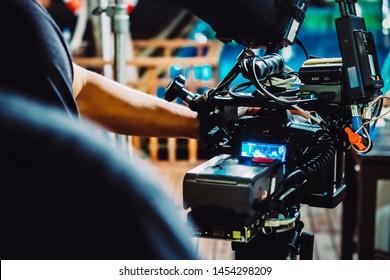 Behind the scene. cameraman shooting film scene with camera