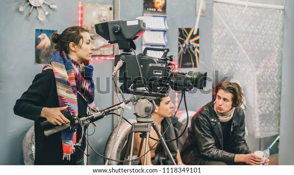Behind the scene. Film crew team filming movie scene on studio. Group cinema set