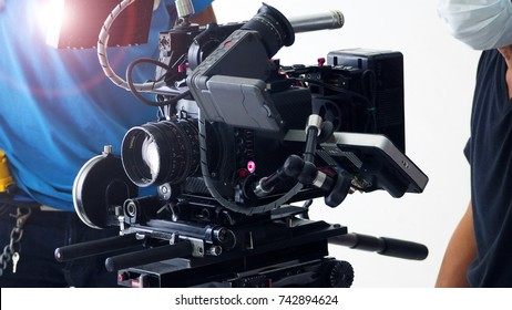 Behind the scenes of 4K high definition video camera shooting and film crew production team in studio.
