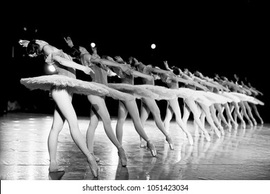 behind the scenes of Ballet.  troup of classical  dancers on stage before the show begins. elegant and graceful female ballet dancers, moving, dancing and jumping synchronously