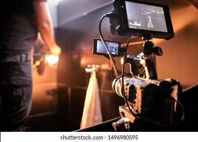 Behind the scenes of filming films or video products and the film crew of the film crew on the set in the pavilion of the film studio. - Shutterstock ID 1496980595