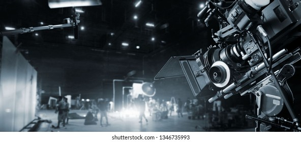 Behind the scenes of making of movie and TV commercial. Film Crew .B-roll. Camera of movie and video production and crew team in studio and set. Black and white.
