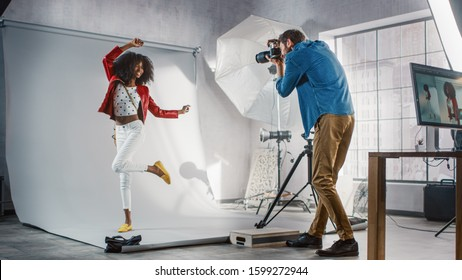 Behind the Scenes on Photo Shoot: Beautiful Black Model Poses for a Photographer, he Takes Photos with Professional Camera. Stylish Fashion Magazine Photoshoot done with Pro Equipment in a Studio