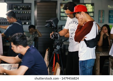 Behind the shooting or filming video movie and film production crew team setting up camera. Jakarta-Indonesia, September 3rd, 2018