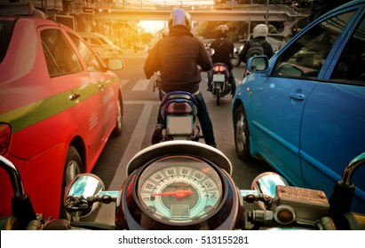 Behind the wheel of the motorcycle in the city - Shutterstock ID 513155281