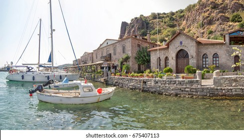 Behramkale Assos, Turkey - July 28, 2013: Old harbor and boats in ancient city of Assos in Canakkale, Turkey.