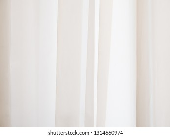 Beige abstract texture with vertical lines. Beige curtains.