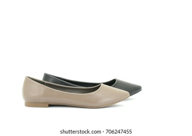 Beige and black flat shoes isolate on white background with copy space.