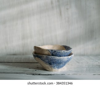 beige and blue ceramic bowls, ceramic bowls, ceramic bowls on white background