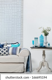 Beige and blue sofa and a coffee table